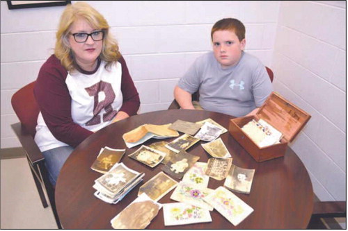 RMS student returns found documents with help of teacher.