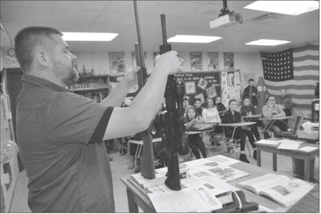 Mike Crawford discusses gun safety with RMS students on Friday.